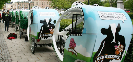 Compared to ordinary cabs these ecocabs have to rely on advertisements to keep them rolling.
