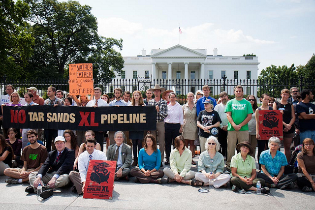 Dozens of environmental activists protested in front of the White House against the proposed Keystone XL oil pipeline that would transport crude oil from western Canada down through the Midwestern region of the US. Photo Credit: Ben Powless.