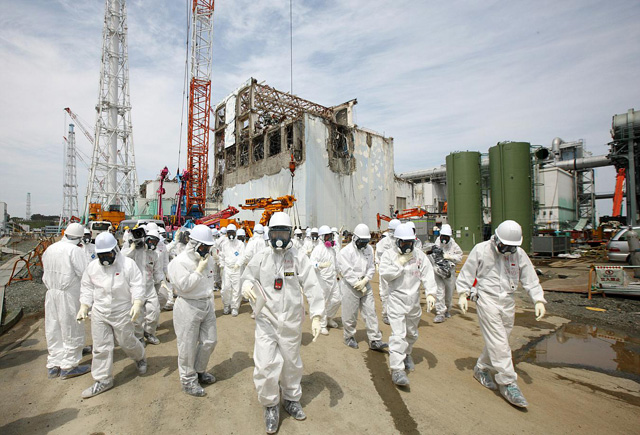 Workers are seen here inspecting the damaged Fukushima nuclear plant.