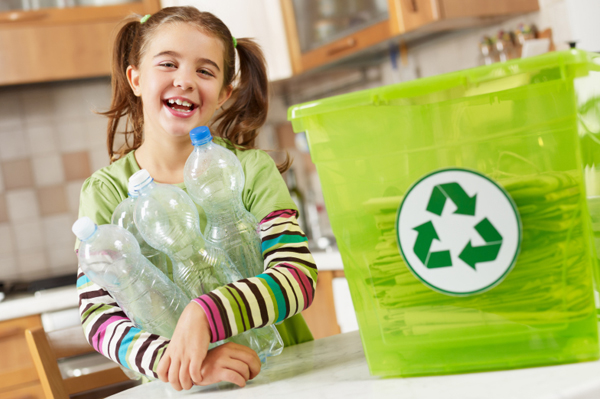 little-girl-recycling-in-kitchen.jpg